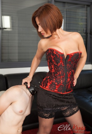 Bodacious red mistress in a corset and stockings with a whip - XXXonXXX - Pic 7