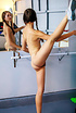Flexible hot brunette with luscious ass exercising…