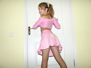 Pigtailed blonde teeny in fishnet tights takes off her clothing - XXXonXXX - Pic 3