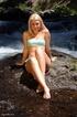 Blonde teen babe takes off her bikini to pose nude…