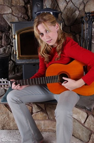 Cute blonde teeny undresses to pose with a guitar - XXXonXXX - Pic 1