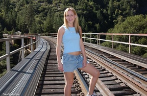 Dirty blonde teen bitch gets nude to pose on the railroad bridge - XXXonXXX - Pic 2