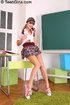 Naughty teen in pigtails and school uniform drilling herself in the classroom