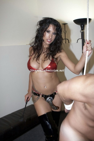Hot brunette mistress in red bra and high boots fucking her fat slave with a strapon - XXXonXXX - Pic 1