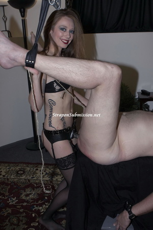 Small-titted tattooed mistress torturing her slave's balls while toying his pooper with a strapon - XXXonXXX - Pic 6