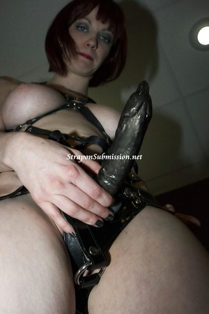 Busty brunette mistress drilling her enslaved dude's ass with a huge black strapon - XXXonXXX - Pic 8