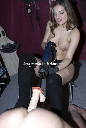 Brunette mom in high boots uses a fucking machine and a strapon to fuck her poor slave - XXXonXXX - Pic 15