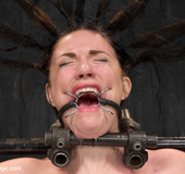 Lusty chick strapped and chained to metal device…