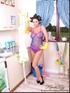Brunette chick pretends to be a housewife in hair-curlers and apron on