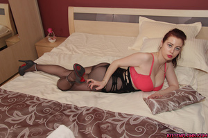 Curvy brunette vixen in a red bra and high heels posing in nylons on the bed - XXXonXXX - Pic 5
