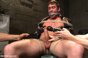 guy roped down gets