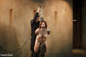 Redhead babe is roped and hung as guy sp - XXX Dessert - Picture 11