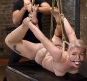 Slim inviting blonde roped and hung gets caned,…