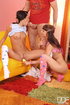 Two cute teen in blue and pink play with dildo before guy joins for threesome