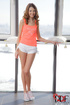 Slim teen beauty in pink top and white shorts gets…