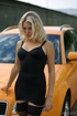 Blonde slips off hot black dress and pantyhose to…