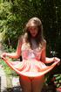 Seductive teen angel in a nice dress in the garden