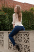 Slim teen redhead in sexy skinny jeans outdoors