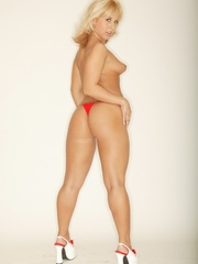 Lusty full bodied blonde in spicy red panties strip nude - Picture 1