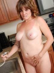 Naughty chubby tattoo chick drops towel in kitchen to - Picture 8