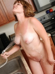 Naughty chubby tattoo chick drops towel in kitchen to - Picture 9