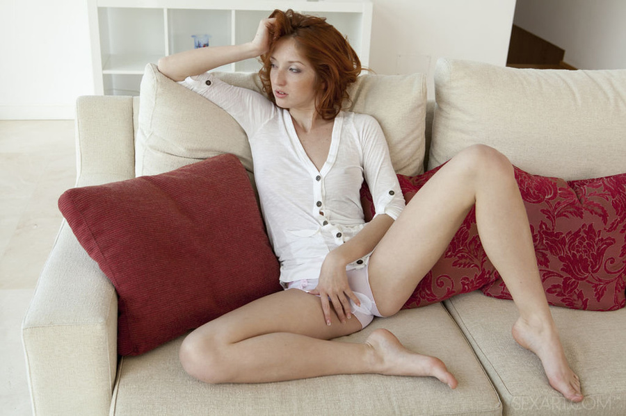 Nude redhead masturbating