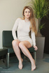 Blonde takes off her long-sleeved dress to show…
