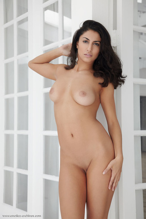 Brunette with dangling earrings naked in - XXX Dessert - Picture 1