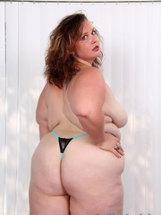 Tattooed brunette BBW in black and blue lingerie gets - Picture 6
