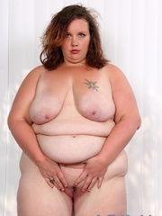 Tattooed brunette BBW in black and blue lingerie gets - Picture 8