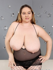 Plump dame in black lingerie and fishnets stripping and - Picture 3