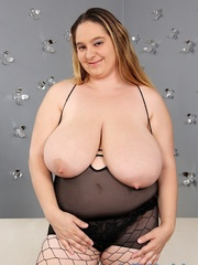 Plump dame in black lingerie and fishnets stripping and - Picture 5