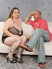 Overweight slut takes some dark meat on a white sofa. - Picture 1