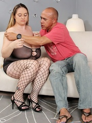 Overweight slut takes some dark meat on a white sofa. - Picture 2