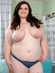 Brunette in a black bra and blue panties disrobes and - Picture 5