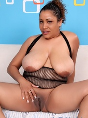 Chubby black woman in black fishnet lingerie opens pink - Picture 10