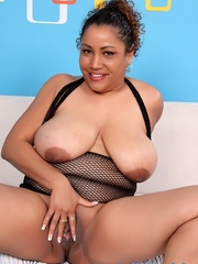Chubby black woman in black fishnet lingerie opens pink - Picture 11