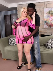 Colossal blonde in lingerie takes large black dong on a - Picture 1