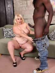 Colossal blonde in lingerie takes large black dong on a - Picture 4