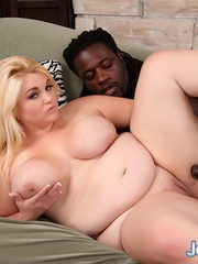 Colossal blonde in lingerie takes large black dong on a - Picture 11
