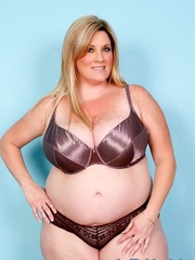 Freckled fatty in black panties and a shiny bra strips - Picture 1