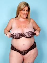 Freckled fatty in black panties and a shiny bra strips - Picture 2