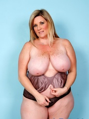 Freckled fatty in black panties and a shiny bra strips - Picture 3