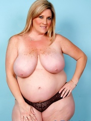 Freckled fatty in black panties and a shiny bra strips - Picture 4