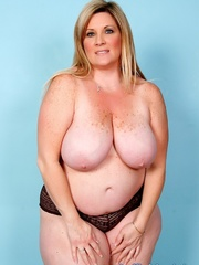 Freckled fatty in black panties and a shiny bra strips - Picture 5