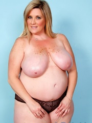 Freckled fatty in black panties and a shiny bra strips - Picture 6