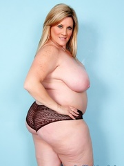 Freckled fatty in black panties and a shiny bra strips - Picture 7