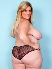 Freckled fatty in black panties and a shiny bra strips - Picture 8