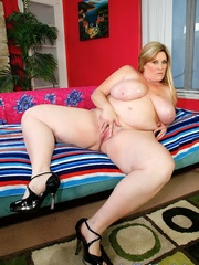 Freckled fatty in black panties and a shiny bra strips - Picture 11