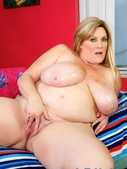 Freckled fatty in black panties and a shiny bra strips - Picture 12